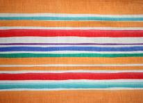 Striped fabric texture orange red green